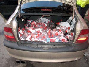 Prins cu portbagajul plin cu alcool